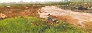 Situação da área da APA do Lajeado em Campo Grande, com entulhos depositados no local. (Foto: Reprodução)