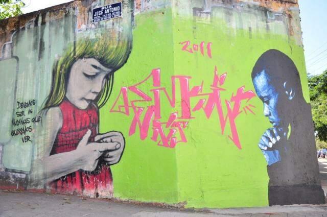Grafite em muro da rua José Antônio, em Campo Grande. (Foto: João Garrigó)