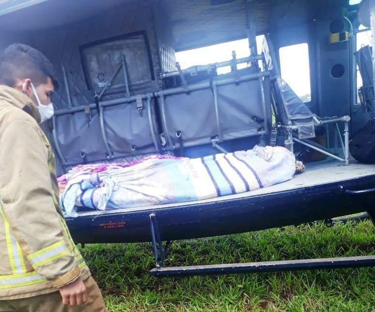 Corpos foram trazidos de helicóptero para o necrotério em Pedro Juan (Foto: Direto das Ruas)