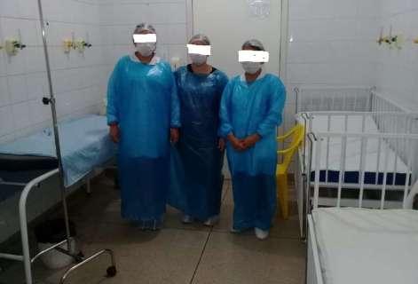 Servidores que vestiam sacos de lixo cobram indenização após contrair covid