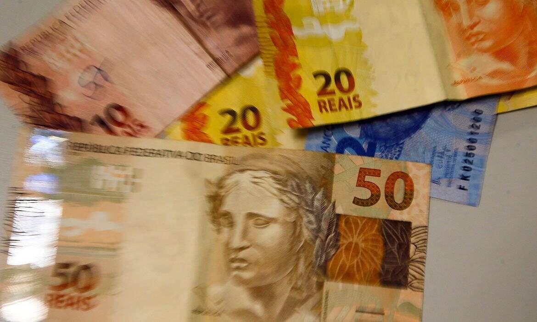 Notas de dinheiro disponíveis para saque (Foto: Marcello Casal Jr/Agência Brasil)