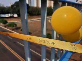 Em pontilhão sobre a Avenida Afonso Pena, ação feita pelo poder público visa conscientizar população (Foto: Caroline Maldonado)